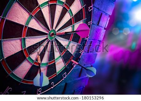 dartboard on a brick wall - stock photo