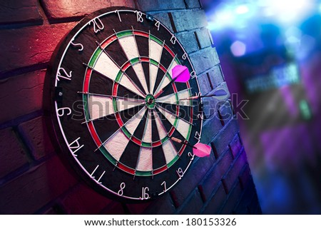 dartboard on a brick wall - stock photo