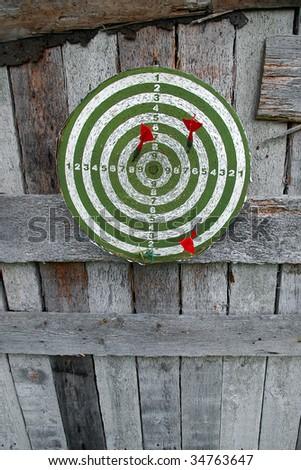Dartboard on wooden wall - stock photo