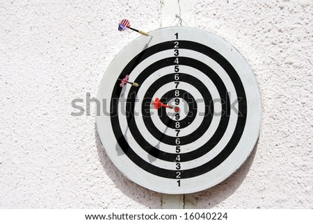 Dartboard with three arrows with flags