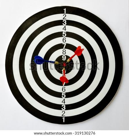 Dartboard with three darts on the bulls eye. - stock photo