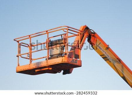 DARTMOUTH, CANADA - MAY 21, 2015: United Rentals/JLG lift. United Rentals is the largest equipment rental company in the world and JLG designs, manufactures and markets industrial access equipment.