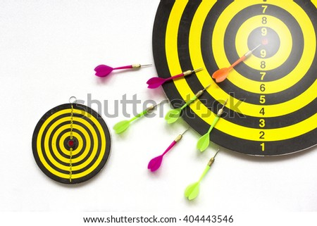 Darts and target on isolated / concept represents a bigger target selection. - stock photo