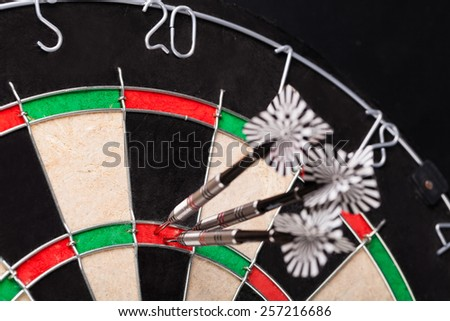 darts arrows in the target - stock photo