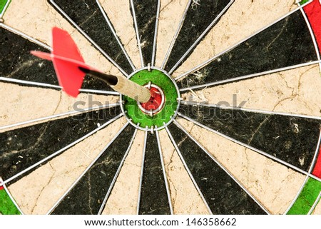darts arrows in the target center bulls eye