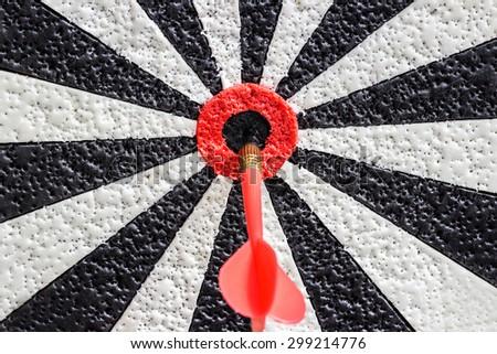 Darts arrows in the target center bulls eye. closeup - stock photo