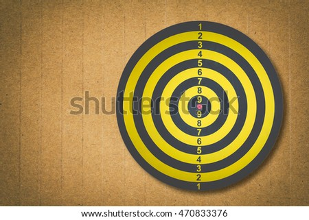 Darts Board on grunge brown paper texture ,symbol of target ,business concept