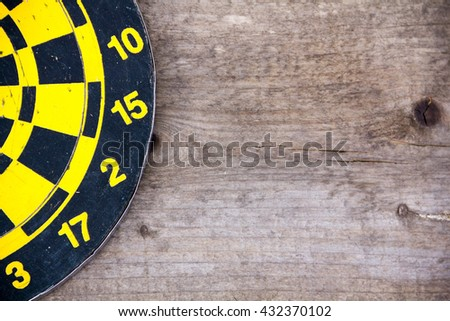 Darts dartboards, on a brown wooden Board. Table for the game of Darts. the success failure of the business concept. Closeup. place for text - stock photo