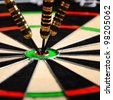 darts hit the target in bull - stock photo