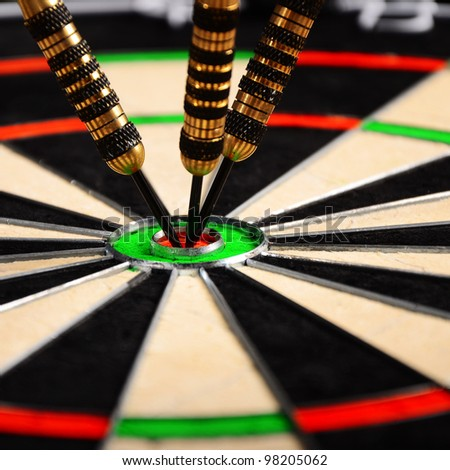 darts hit the target in bull - stock photo