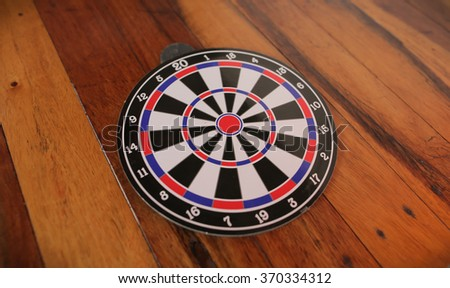 darts isolated on a wood background