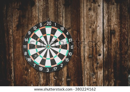 darts on a wooden background