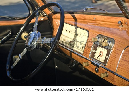 Dashboard of an antique convertible car. - stock photo