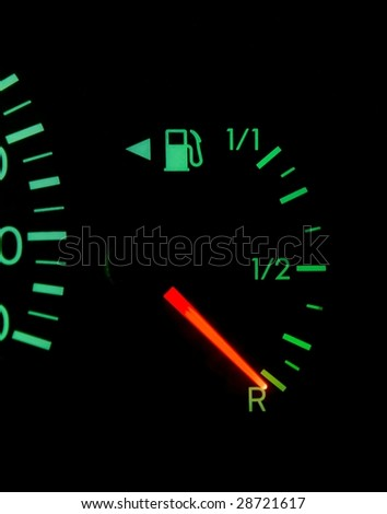 Dashboard showing fuel running out - stock photo
