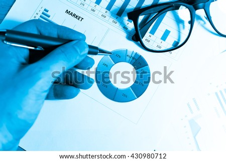 Data analyzing in trading market with pen. Working set for analyzing financial statistics and analyzing a market data. Data analyzing from charts and graph to find out the result. - Mono tone.