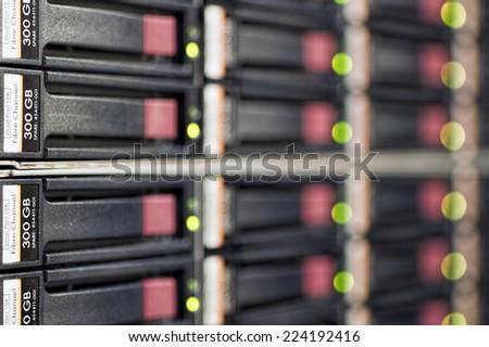 Data Center Hard Drives Hard rive array in a data center server rack. - stock photo