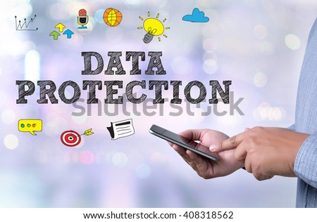 DATA PROTECTION person holding a smartphone on blurred background - stock photo
