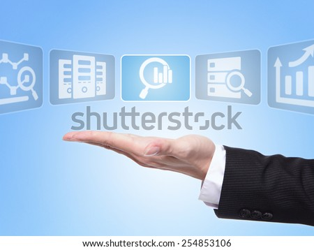 data science concept , business man hand palm holding all kinds of icon about data science with blue background