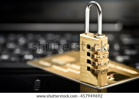 Data security concept with padlock on laptop computer keyboard and credit card - stock photo