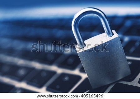 Data Security Encryption Photo Concept with Metallic Padlock on Laptop Computer Keyboard. - stock photo