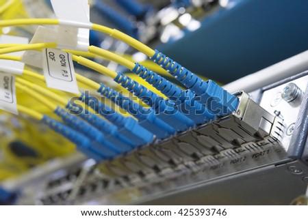 Data transfer by optical fiber optic information technology. - stock photo