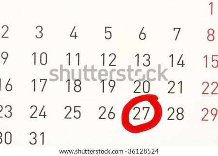 date circled on a calendar - stock photo