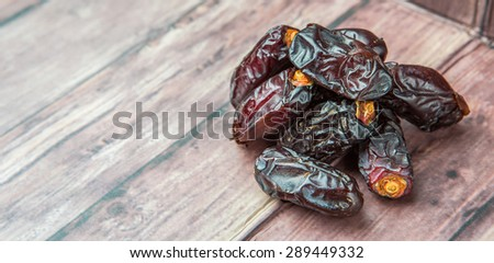 Date fruits over wooden background - stock photo