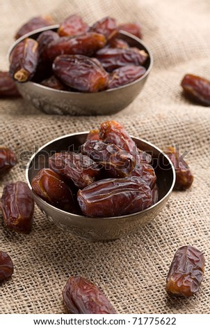 date in little bowl on a natural background - stock photo