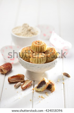 Date maa'moul arranged with date fruit and raw ingredients. Typical middle eastern cuisine. - stock photo