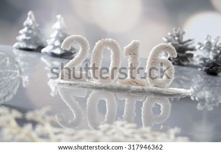 Date New Year 2016 made of snow isolated on winter snow background - stock photo