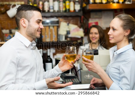 Date of young couple drinking wine at bar and smiling  - stock photo