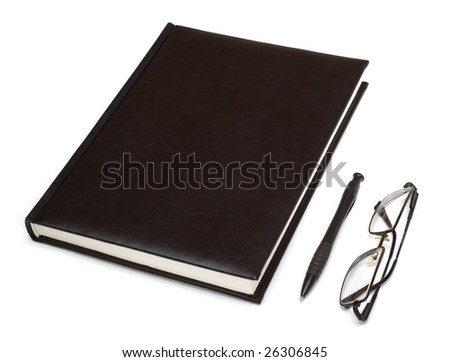 Datebook, pen and glasses. Isolated on white - stock photo