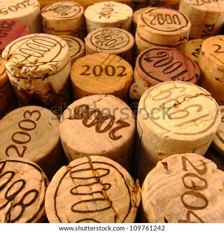 Dated Wine Bottle Corks with Staggered Heights. View 2. - stock photo
