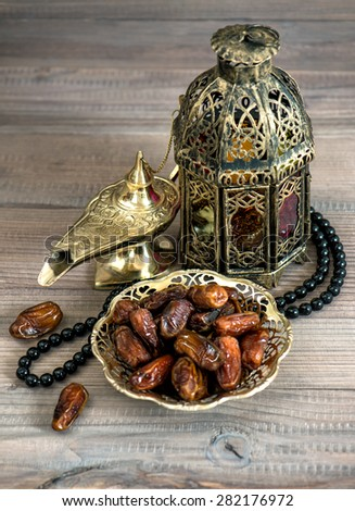 Dates, arabic lamps and rosary. Islamic holidays concept. Festive decoration - stock photo