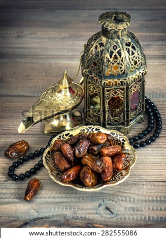 Dates, arabic lamps and rosary. Islamic holidays concept. Festive decoration. Vintage style toned picture - stock photo