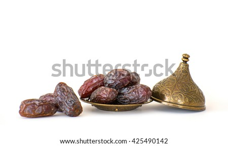 Dates in a bronze bowls