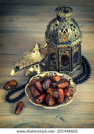 Dates, oriental lamp, lantern and rosary. arabic holidays concept. Eid Al Adha mubarak - stock photo