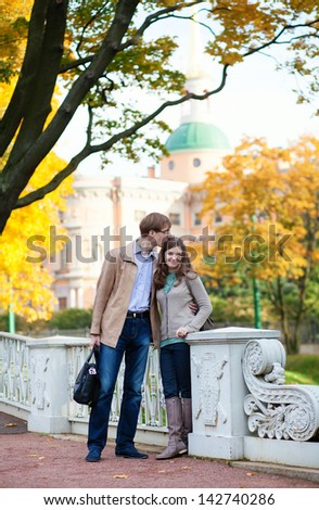 Dating couple on a fall day in Saint-Petersburg, Russia - stock photo