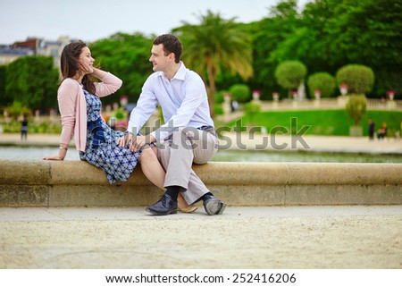 Dating romantic couple in the Luxembourg garden of Paris - stock photo