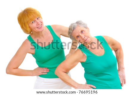 daughter and mother doing gymnastics on white background - stock photo