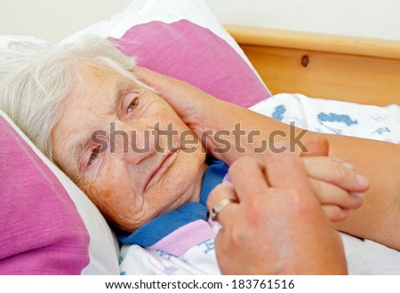 Daughter caress on the cheek her elderly mother - stock photo