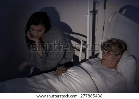 Daughter caring about mum staying in hospice - stock photo