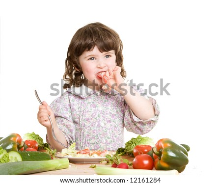daughter cooking salad at the kitchen - stock photo