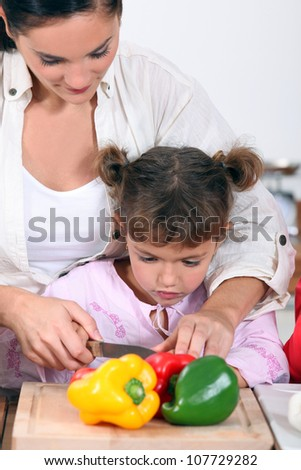 Daughter cooking with mother - stock photo