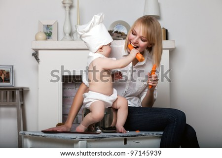 daughter feeds the carrot's mother