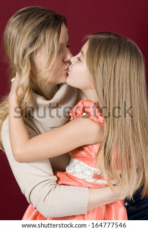 Daughter gently kisses his mother