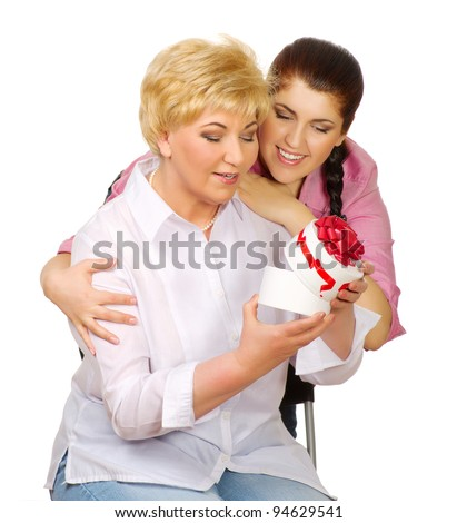 Daughter give gift to her mother isolated - stock photo