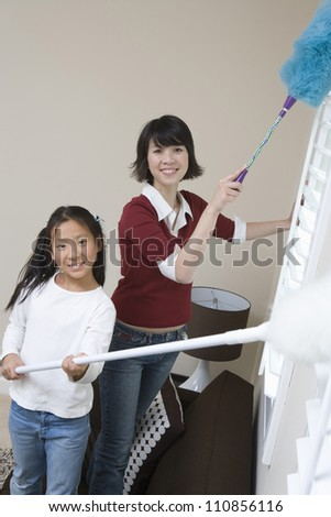 Daughter Helping Mother At Household Work