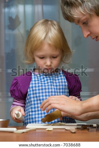 Daughter helps mother on kitchen