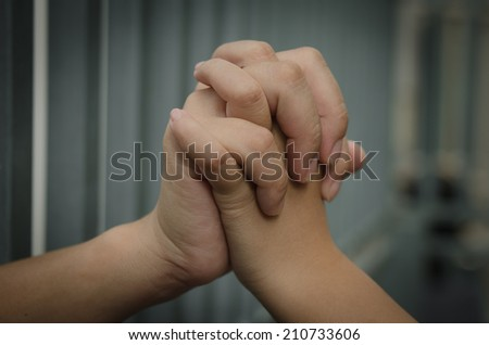 Daughter holding the hands of her mother - stock photo